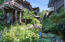 Custom Japanese Garden with moving stream transitioning to a 5' deep Koi Pond, surrounded by beautiful plantings.