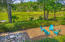 View from elevated screened porch into marsh and private fenced in backyard.