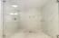 floor to ceiling tiled walk in shower