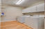 Laundry room with cabinet storage