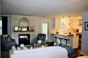 Great Room with double-sided gas fireplace.