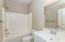 Shared full bath for the 2 additional bedrooms.