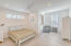 spacious master bedroom with balcony and attached office/bonus room