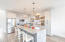 eat-in kitchen island with quartz countertops, new appliances and custom shelving and cabnitery