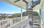 balcony off of main living area with expansive water views