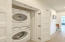 new stackable washer and dryer located on living area