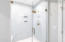 master bathroom walk in shower with custom tiling and shower head