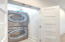 utilities room with stackable washer/dryer