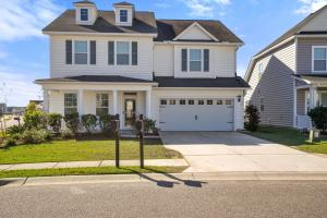 Beautiful white Colonial Traditional home in FoxBank Plantation