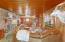 Pine plank ceiling & floors warm this favorite space