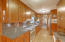 Granite surfaces, stainless GE Profile appliances including refrigerator, microwave, dishwasher & smooth top electric range.