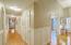 Red oak hardwood flooring, solid wood wainscot, doors, molding & trim. Built for forever!