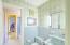 2nd floor Vintage Jack-n-Jill bathroom. Built in linen closet, cabinetry and dressing vanity.