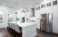 large marble kitchen island, cabinets to the ceiling, glass cabinets