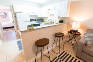 Eat in kitchen with table and countertop dining