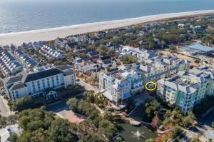Ideal location on The Sweetgrass Plaza steps to the beach!