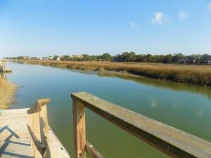 Waterfront--deep water w dock. Wonderful home on almost 1 acre minutes to  beach! Renovated in 2018. No HOA!Welcome home to Oak Island, hidden in the trees- landscaped lot, deep water tidal creek! Entertain w large living areas  living rm, dining rm, den w fireplace, Kitchen w rm for more then 1 chef! Upstairs 5  spacious bedrms.  Master has water views, large walk in shower, dual vanities, 2 closets plus a room off great for large walk in, exercise, office...etcWaterfront spacious outdoor living- Screen porch, large deck& patio. Great place to entertain, relax ,enjoy watching  dolphins! Dock,& floating dock to tie your boat up! Minutes to Folly Beach +Restaurants! Room over garage- use as 6th bedrm, man cave. Room for  your vehicles & toy. Agent related to seller. Flood ins $2568appro