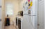 Laundry Room Next to Kitchen. Includes an Extra Refrigerator with Ice Maker
