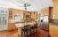 Large island & lots of kitchen cabinets. Transom windows.