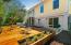 Raised garden/patio in rear yard.