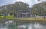 Nestled near the Intracoastal Waterway is a well maintained one-family owned residence that is located on the quiet shore of Hamlin Creek with the best deep water access that IOP has to offer.