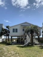 Wonderful ocean front cottage!!  Exterior freshly painted! Interior recently updated! Very cute! Light, bright, and airy!! 3 Bedrooms, 2 full baths. 4th bedroom is now aspacious laundry room. Living room opens to a screened porch and deck area. Hardwood floors. House sold FULLY FURNISHED! Septic was inspected and pumped less than 1 year ago. Lots of space for parking!Beautiful ocean views!!