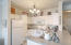 Kitchen is crisp, clean & open to entertain!