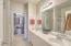 Owners bathroom offers dual vanities.