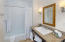 Full bathroom with upscale finishes.