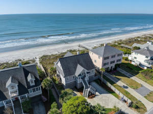 Welcome to ''Sunrise, Sunset.''  Rare opportunity to acquire a large oceanfront home on the west side of Folly Beach.  This well maintained 3 bedroom, 4 baths home feels very spacious thanks to large rooms and a 2 story ceiling in the living room.  The ocean views from the living area, kitchen, dining, ALL the bedrooms are magnificent.  The kitchen and baths feature classic tile that add to the relaxed beach vibe.  Each bedroom has its own ensuite bath.  The large decks on the ocean will allow for large gatherings. The family room has a gas fireplace for the cooler months.  The large 1st floor master bedroom has access to the oceanside deck.  The ensuite bath features a jetted tub, a bidet, dual sink vanities, and shower. The kitchen features a large island and lots of cabinets... The adjoining dining area with its numerous windows light up the area.  The large laundry room comes with a pantry cabinet, closet space, and laundry sink with countertop space.  The home is being sold fully furnished with some exceptions.  Vacation rental bookings for 2021 are about $130,000.00 so far.