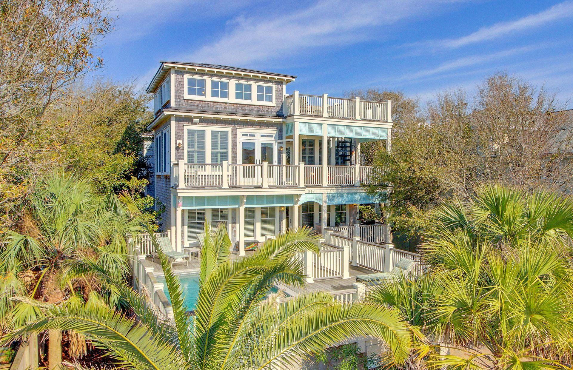 """This home was built in 2004 by Thomas Evans Construction, one of the island's finest builders. The home was renovated in 2011, has since been well-maintained and is currently a super performer on a vacation rental program, It would also make a great primary or second home. This one has all the bells & whistles including an elevator to all three floors, an elevated pool, and ocean views from the roof deck. No expense was spared in the custom bead-board and V-groove paneling, plus plantation shutters. The great room has dramatic high ceilings, clerestory windows and a fireplace flanked by custom built-ins. You will love the open reverse floor plan with the living areas on the top floor. High end finishes include cherry hardwood floors, maple cabinetry, tile and natural stone. Please click The kitchen is state-of-the-art with black granite counters, separate wine refrigerator, and stand-alone ice maker. There is island seating and the dining room features a long farm table to seat a crowd. There is a walk-in pantry and a powder room nearby. There is one master bedroom on the main/top level, as well as an office currently used as bedroom #7. A covered porch on this level has spiral stairs leading to an ocean view roof top deck.Down one level is a second master bedroom and another deluxe master bath.  This level has two rear bedrooms with a shared bath between them.  One is furnished with a king size bed and the other has a queen bed. A """"bunk"""" bedroom that sleeps four, the front queen bedroom, laundry room and a hall bath complete the middle level.The elevated pool is accessed from the middle level of the home.  There is a large sundeck surrounding the pool as well as a covered porch for those who prefer the shade.The ground level (which meets the required minimum elevation for flood insurance) has a large game room, a wet bar and a full bathroom. There is also a very large owner's storage room located on this ground level. A rear patio off the game room and a two car ga"""