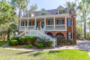 Southern elegance in this beautiful elevated home designed by Hilton Googe