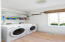 Bright and light Laundry room with lots of storage
