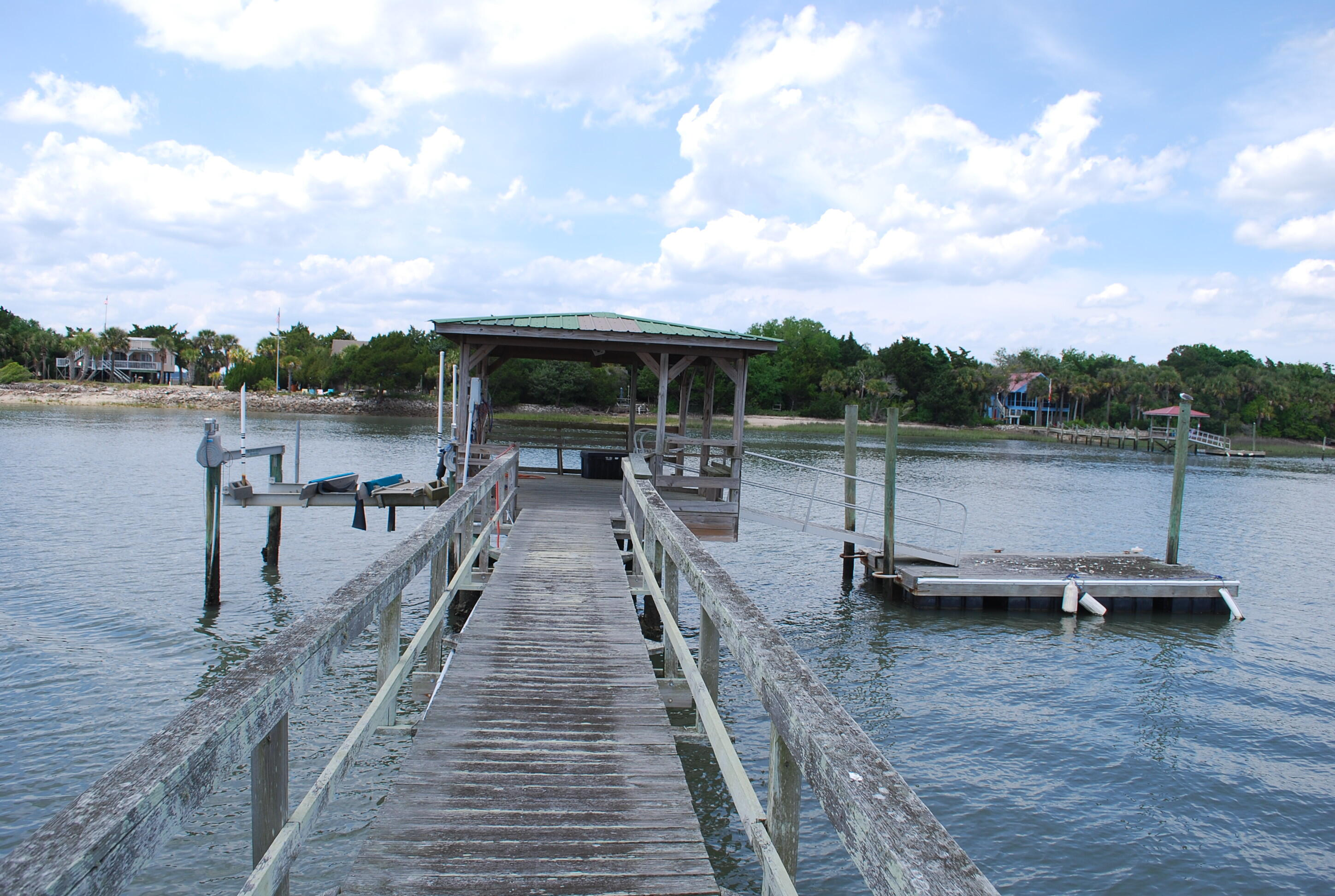 Huge waterfront lot with trees galore.  Perfect opening in rear of lot for the estate home to be built.  No other lot this size on the island.  There is an existing home, but no value is being given.