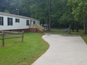 If you are looking for privacy and peace and quiet, look no further. This 3 bedroom 2 bath manufactured home is located on a nice quiet street on a large, treed lot with lots of privacy. The property features a large concrete driveway, fenced in area, storage shed and brick foundation. The home has an open floorplan with laminate flooring in the living room and kitchen. The kitchen features lots of cabinets for storage and a large eat in area. The master suite has a walk-in closet and bathroom with separate shower and soaker tub. The other two bedrooms are of good size and share a 2nd bath. The home has been freshly painted and is move in ready. Schedule your showing today as this one won't last long.