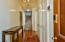 The foyer has built in double coat and storage closets and newly installed heart of pine floors.