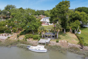 1303 Battalion Drive is a James Island opportunity unlike anything else available right now. A house on the water with nothing but potential; this 3BDR/ 2.5BA is perfectly placed on the lot just waiting for a pool to be built with an existing fence and covered dockhouse. You get a sunrise and sunset, views of the lighthouse and Long Island; nothing but vast views of the Lowcountry. There is no HOA in the Secessionville subdivision, and the lot is .48acres -- stand-up paddle board, boat, build a pool, sail -- the outdoor life is calling. The sellers purchased solar panels that will stay, and do produce electricity that they sell back to the power company. They save an estimated $200/ month, and their value is around $17K. When you enter the home from the front door you have a gorgeous stone tiled entry/ drop zone and large living room with wood burning fireplace. The entire backside of the home looks out at the creek, and it is nothing short of spectacular. The eat-in kitchen is just off the living room with a formal dining room on the front side of the home. The second story is where you have 3-bedrooms, a shared bathroom and primary bedroom with en suite bathroom. The backyard is fenced in, with plenty of room for a pool. There is a grandfathered boat ramp to the left of the dock if you are facing the water; just needs to be repaved! You are just 4miles from Folly Beach and an easy 20minutes from Downtown Charleston and the airport.