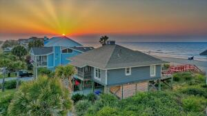 Enjoy unobstructed ocean front Sunrises and Folly River Sunsets from one of the most sought after locations on the East Coast Imagine the sound of waves gently crashing on the sand. Feel the salty, ocean breeze greeting you on the private dune walkover which is connected to the wooden deck. Built into that deck is a screened-in porch with comfortable chairs for afternoon naps. . Beneath the house is the essential outdoor shower and  large deck gathering area for socializing and sun bathing. On the other side of the home is another deck with a porch swing from which you can relax and watch the sun set over the marsh and Folly River. Inside, this home has an open floorplan with beautiful wood flooring throughout. The property has been remodeled and decorated with low country living in mind.