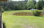 View of pond from rear screened porch