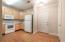 Spacious kitchen with hardwood floors