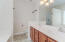 Owner's bath has dual sinks and separate shower and tub