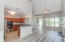 Kitchen overlooks entire family room