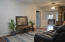 Living Room or Dining Room, or Family Room with Beachy Beadboard walls (from hallway towards the kitchen)