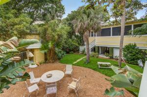 """Take a look at this one of a kind 3-cottage compound located directly in the heart of beautiful Folly Beach.  Daffodil's, as they are affectionately known, is a wonderful mix of vintage Folly architecture perfectly blended with modern elegance.  ''Big Daffodil'' is a gorgeous and modern, raised & spacious 2BR/2Bath cottage (approx. 1700 sq/ft) with stunning heart of pine flooring, extra tall ceilings and doorways and beautiful wood beamed ceilings in the two living rooms. The Chef's kitchen is enormous with stunning granite counters, gas cook-top range and stainless steel appliances,  The Butcher block island and the tons of counter space are ideal for entertaining family & friends of any size. Two wonderful living room/family room seating areas allows everyone space to relax and the super large screened in porch only adds further to this outstanding living space & layout.  The Master bedroom is large and has its own en-suite bath.  The 2nd bedroom has direct access into the 2nd full bath as well as walk out doors to the aforementioned huge screened in porch. Below this cottage is a wonderful entertaining area complete with a full wet bar, shuffle board, ping-pong and foosball tables which are just perfect for entertaining kids and adults of all ages.  Rinse off after a day at the beach in the private outdoor shower and grab a seat in the beautifully landscaped yard while enjoying your favorite beverage and even a bite to eat.   The """"Little"""" & """"Wee"""" cottages are vintage 1950's beach cottages that are approximately 600 sq/ft each that have been meticulously updated and maintained.  Each are unique and offer wonderful 1Bedroom accommodations with plenty of room.  The """"Little"""" cottage also has its own private screened in porch off of the living room while """"Wee"""" cottage has it's own private open aired deck off the rear allowing both cottages two outdoor seating areas for guests to relax and take in the Folly vibe.  This property is only 1/2 a block from Center St & just"""