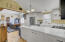 Kitchen with vaulted celiling opens to dining area/family room