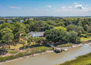 This location and view cannot be beat! Imagine fishing, taking out the boat or having family and friends enjoying the water right from your backyard. This is the Lowcountry dream! Located on a quite cut de sac, this home feel far from everything but is close to everything! Folly Beach is 2.1 miles away, Harris Teeter is 2 miles away....all the fun of being near Folly without the weekend traffic jams. The home is very livable but could use some updates. This property has been loved by one family since being built and has a dock with floater and views of the Morris Island Lighthouse. Home has not been updated and all offers must be for ''as is'' condition.