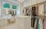 Closet one in Master Suite with custom dressing vanity