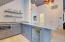 Apartment kitchenette with microwave, Subzero refrigerator and dishwasher drawer