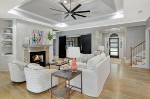 Open living room with modern gas burning fireplace