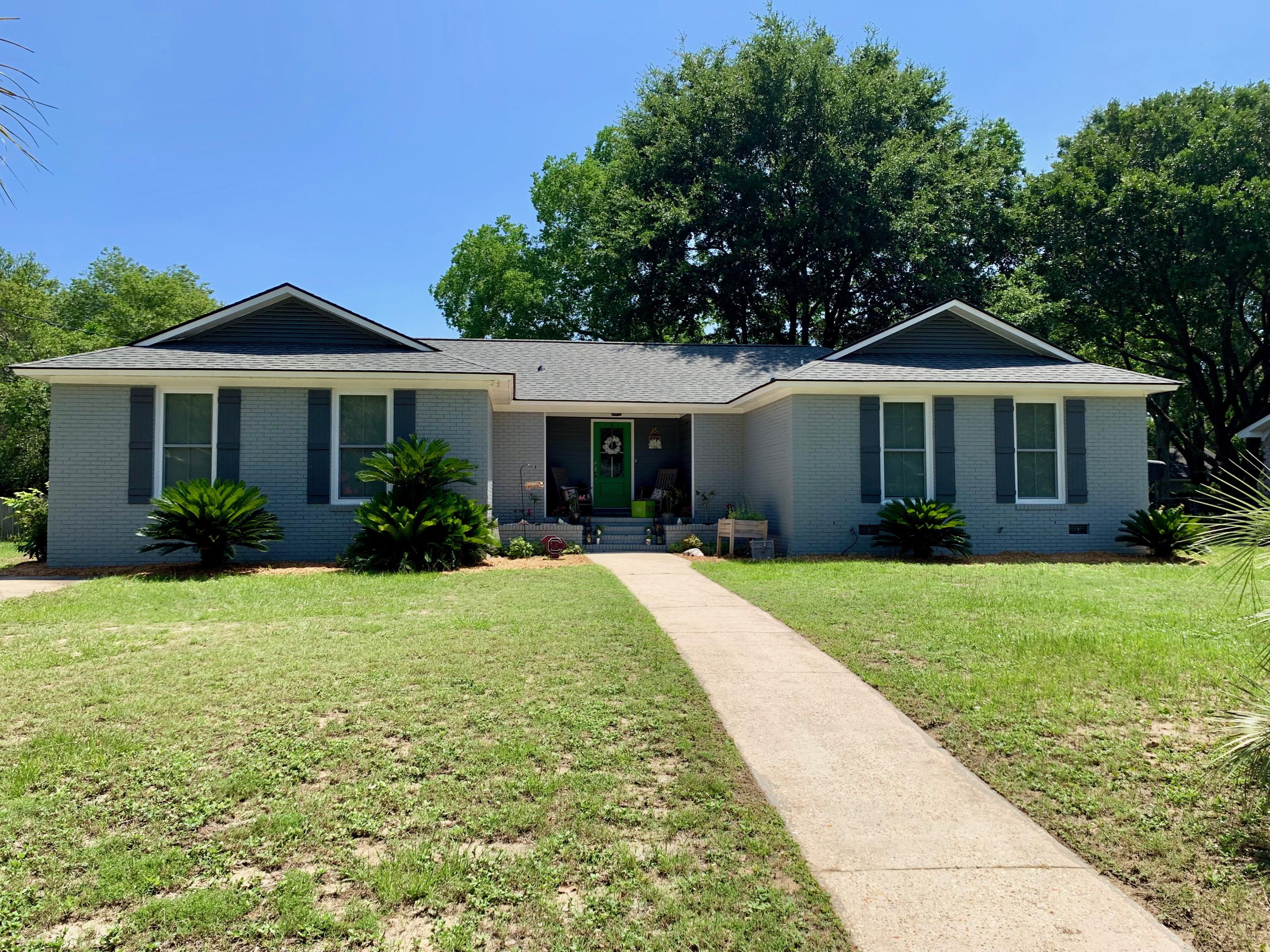 LOCATION does not get much better than this in the heart of Mt Pleasant! Walk or bike ride to Shem Creek and the Ravenel Bridge and drop your boat in the water at the community boat ramp! NO HOA! This 4 BDDR brick ranch was renovated in 2017....new windows, new roof, new flooring, new kitchen and new baths with beautiful cabinetry, tile shower/tub surrounds and granite countertops! Add to that TWO family living spaces, a large 2 car detached garage, and a large fenced in back yard with a deck with this wonderful home in the ''heart'' of town! Enjoy one of Mt Pleasant's most sough after neighborhoods in Cooper Estates!